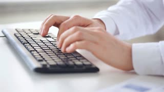 male doctor hands typing on keyboard