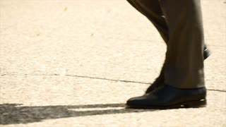 male person walking. slow motion. close up. business people background