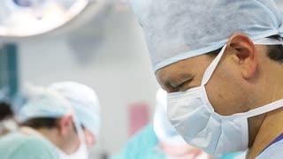 Male surgeon working in operation room