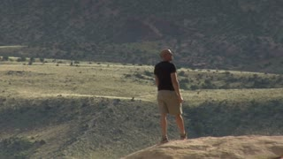 Man Admires View In Capitol Reef National Park
