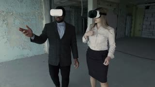 Man and woman discussing future interior of room in unfinished building in oculus rift goggles VR glasses