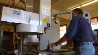 Man Change His Head On Industrial Lathe