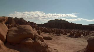 Man Climbs Over Rocks In Goblin Valley Utah