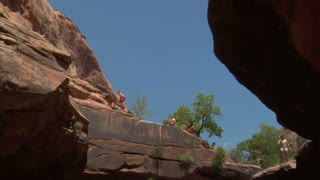 Man Does Flip Off Of Red Rock Cliffs Into Water