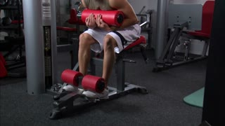 Man Doing Ab Workout in Gym Weight Room