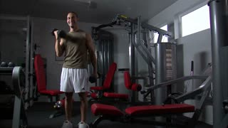 Man Doing Arm Curls with a Pair of Dumbbells 2