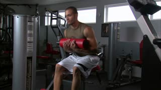 Man Doing Sitting Curls in Gym Weight Room 2