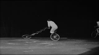 Man Doing Tricks on Unicycle