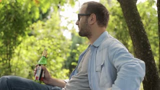 man drinking beer in the garden