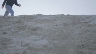 Man Falls Down Sand Dune