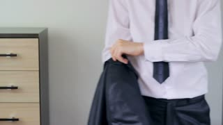 Man getting ready for job, putting his suit