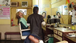 Man getting straight razor shave in barber shop ecuador