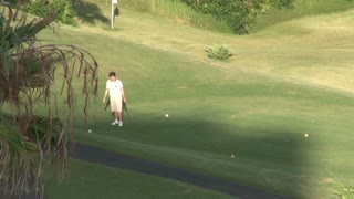 Man Golfing on Golf Course