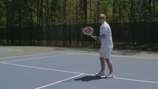 Man Hitting Back Tennis Balls