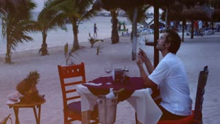 Man in beach restaurant
