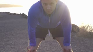 Man jogging on the beach and looking to the camera, slow motion shot at 240fps