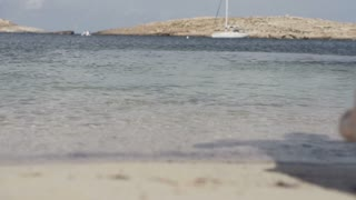 Man jumping into the sea, slow motion shot at 240fps