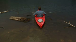 Man Kayaks On Calm Lake In Slow Motion