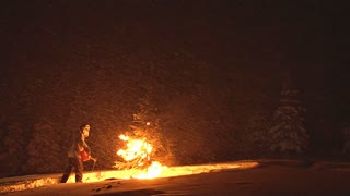 Man Lighting Christmas Tree on Fire