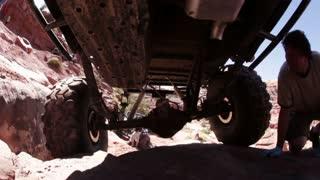 Man looking under jeep