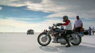 Man On Harley-davidson Motorcycle Takes Off On Bonneville Salt Flats