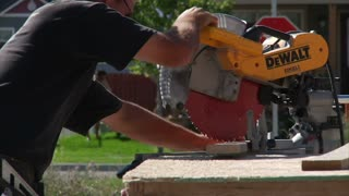 Man Operates Chop Saw