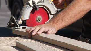 Man Operates Circular Saw