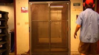 Man Operates Industrial Elevator