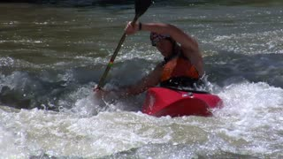 Man Paddles In Whitewater Kayak Slow-motion
