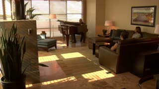 Man Plays Grand Piano For Two Women In Hotel Suite