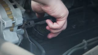 Man Putting Oil in Car Close Up