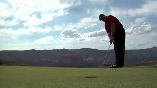 Man Putts Golf Ball And Misses