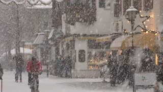 Man Riding Bike In Snow Storm