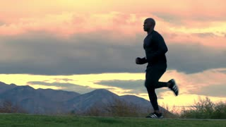 Man Running in Slow Motion with Mountain Backdrop 2