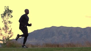 Man Running in Slow Motion with Mountain Backdrop