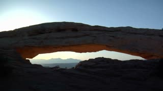 Man Runs Across Mesa Arch Canyonlands National Park