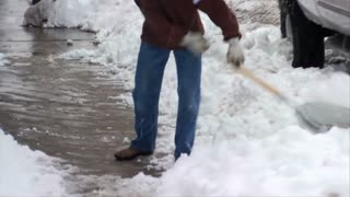 Man Shoveling Snow Park City Utah