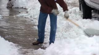 Man Shoveling Snow Park City Utah