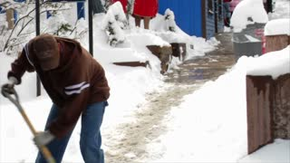 Man Shovels Snow On Main Street In Park City Utah