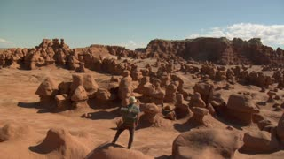 Man Stands On Boulder Goblin Valley Utah