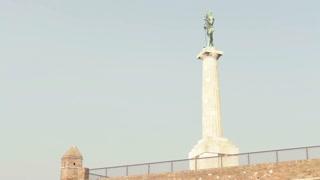 Man Statue On Stone Pedestal