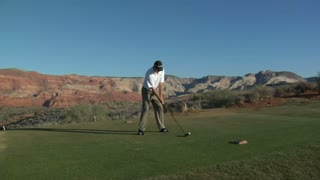 Man Tees Off On Desert Golf Course