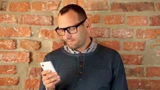 Man texts friends from his apartment