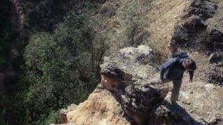 Man trekking and rappeling