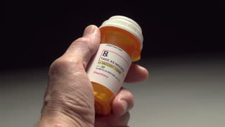 Man unable to open a pill bottle