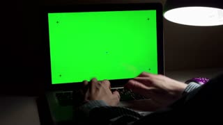 man use a laptop on his desktop with various hand gestures (scrolling, touching,typing) .Indoor.Green screen