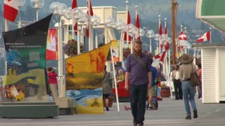 Man Walking On Canadian Boardwalk