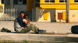 Man With Baby On Street