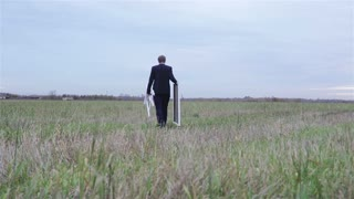 Man With Easel And Canvas In The Field