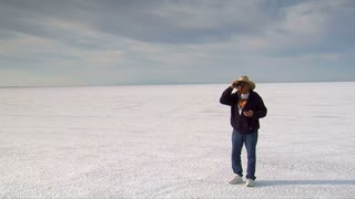 Man With Stopwatch And Binoculars Watches Racers On Bonneville Salt Flats